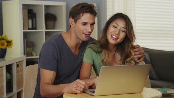 Thumbnail for Interracial couple using laptop together
