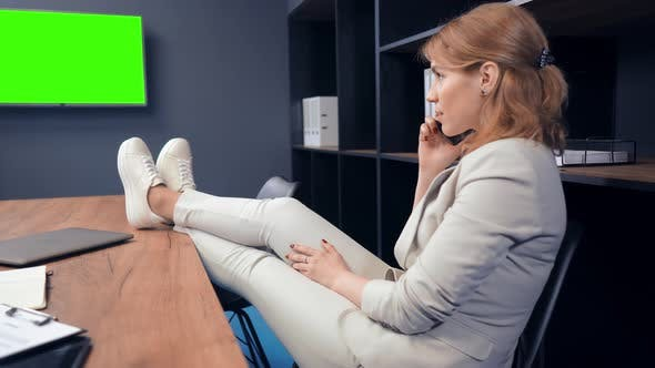 Thumbnail for Attractive Office Woman Sitting at Table in Office