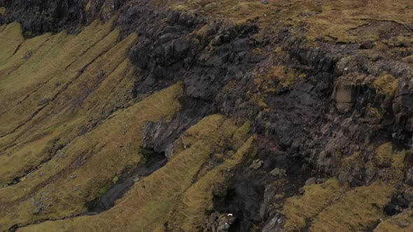 Drone Flight Over Rock Mountain Slopes Of Faroe Islands