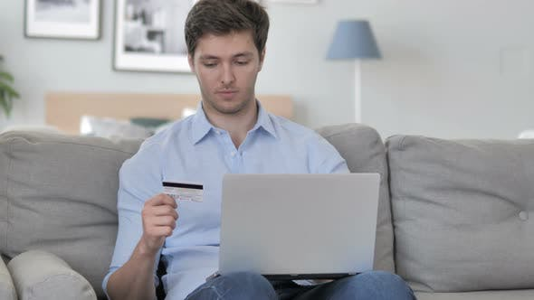 Thumbnail for Excited Man Successfully Shopping Online with Credit Card