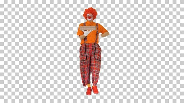 Male clown carrying a present, Alpha Channel
