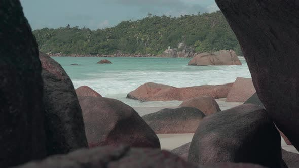 Thumbnail for Seychelles. Praslin Island. Clean Waves Roll on the Sandy Beach and Large Stones Lying on the Sand