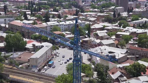 Workers Are Repairing The Crane