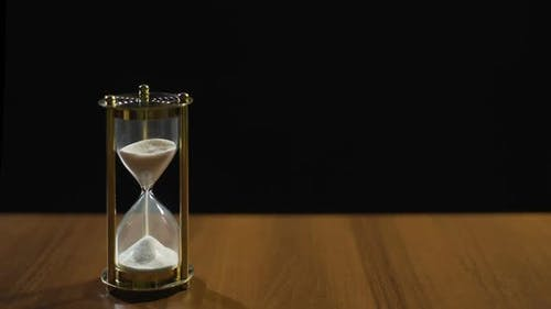 Sandglass Measuring Time by Sand Flow Life Passing Quickly Time Management