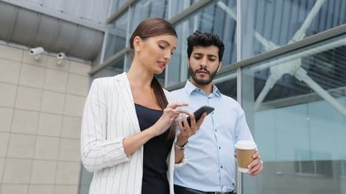 Business People Going To Work With Phone And Coffee On Street