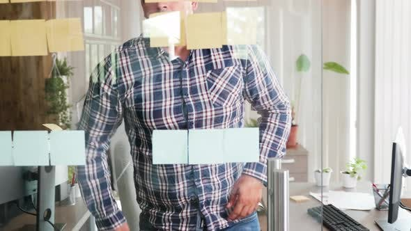 Cover Image for Young Man Team Leader Looking for Solution with His Creative Manager on Sticky Notes