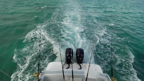 Motor Boat with Fishing Tackles Sailing in the Ocean
