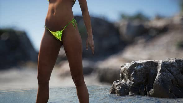 Thumbnail for Beautiful Woman in Sexy Bikini Near the Rocks