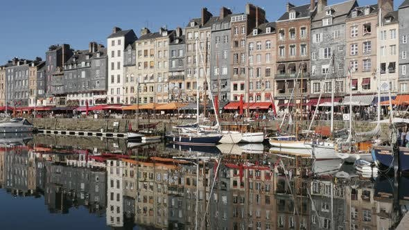 HONFLEUR, FRANCE - SEPTEMBER 2016  Normandy The Vieux Bassin port  by the day with colorful facade r