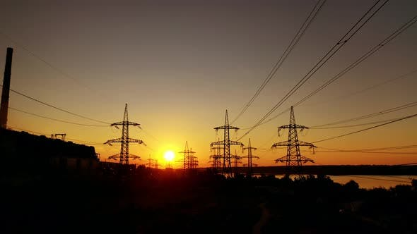 Voltage high electric lines at sunset