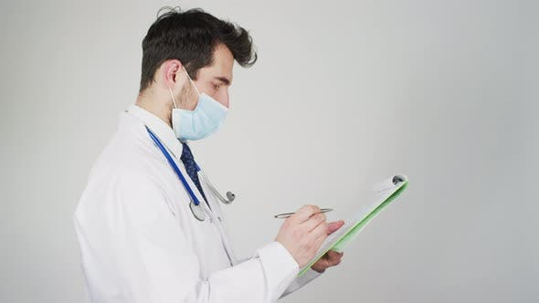 Cover Image for Doctor signing a paper