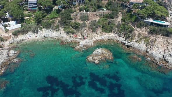 Thumbnail for Drone View of Rocky Beach in Small Blue Bay