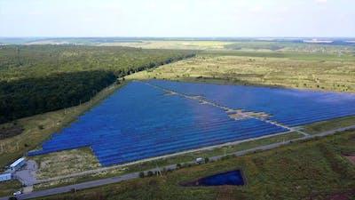 Field Of Solar Panels. Alternative energy creation in a solar park