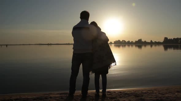 Thumbnail for Man and Woman Standing Near the Sea Shore at Dawn