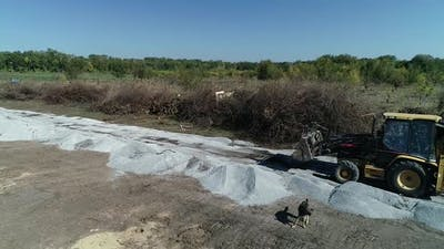 Drone View of a Construction in the Field Excavator in the Field
