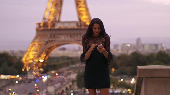 Beautiful Young Girl Taking Selfie with Her Mobile Phone Near the Eiffel Tower
