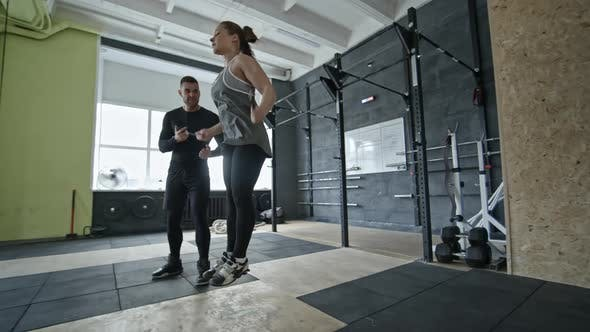 Thumbnail for Woman Doing Jumping Rope Exercise with Coach in Gym