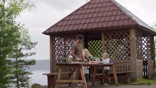 Family Preparing for Picnic in Scenic Spot