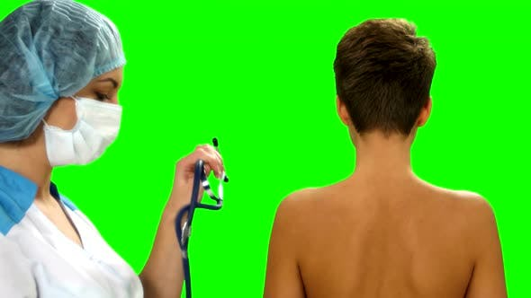 Thumbnail for Doctor Listens Examining Lungs of a Female Patient with Stethoscope on Green Screen