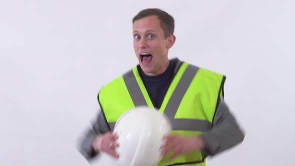 Thumbnail for Portrait of Builder in Uniform Dancing Wild Dance in the Studio
