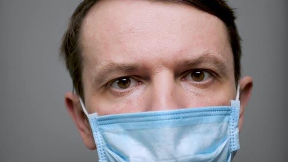 Thumbnail for Unshaven Man Takes Off Protective Mask. Protective Measurements. Coronavirus Covid-19 Social