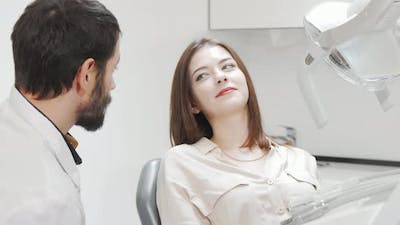 Lovely Young Woman Having Her Teeth Checked By Dentist