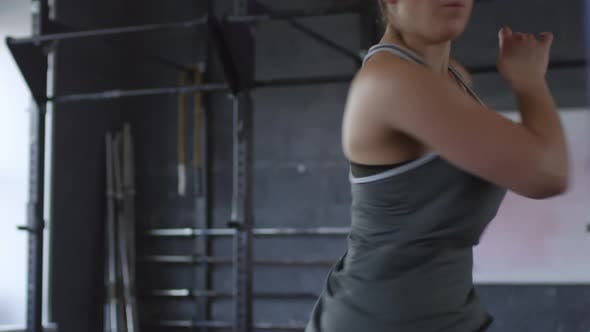 Professional Female Athlete Having Intensive Workout in Gym