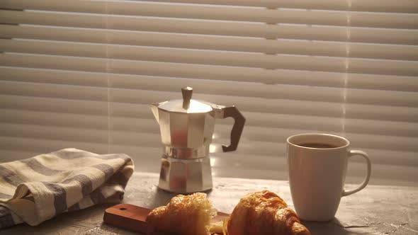 Thumbnail for Food and Drink Concept. Morning Breakfast - Coffee and Croissant on a Table