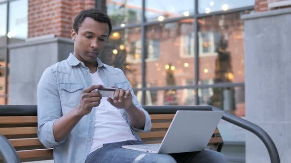 Thumbnail for Online Shopping Failure for African Man Sitting on Bench