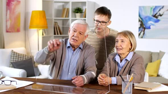 Thumbnail for Grandparents and Grandson Using Invisible AR Display