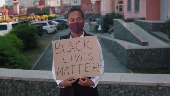 Thumbnail for African-American Woman Holding Sign Black Lives Matter