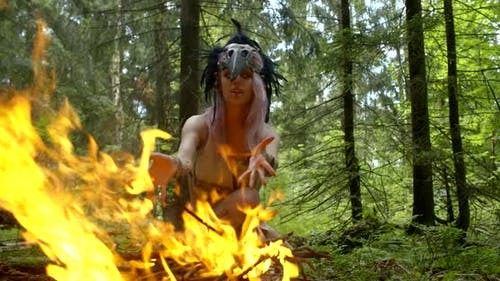 Ancient Savage Witch Is Burning Fire in Forest for Calling Rain, Moving Hands