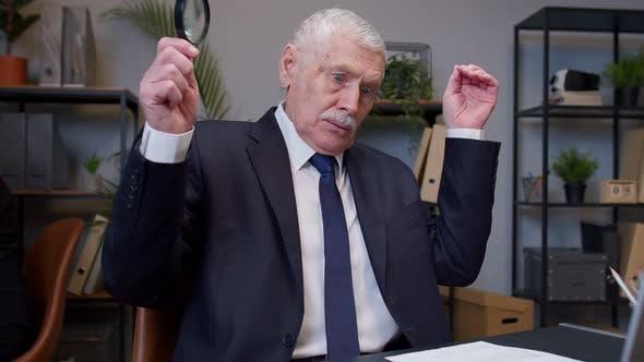 Elderly Old Businessman Checking Paperwork Correspondence at Office Shocked Surprised Disbelief