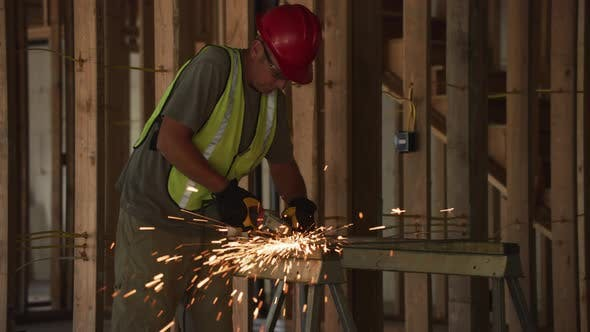 Thumbnail for Construction worker grinding metal and making sparks, slow motion