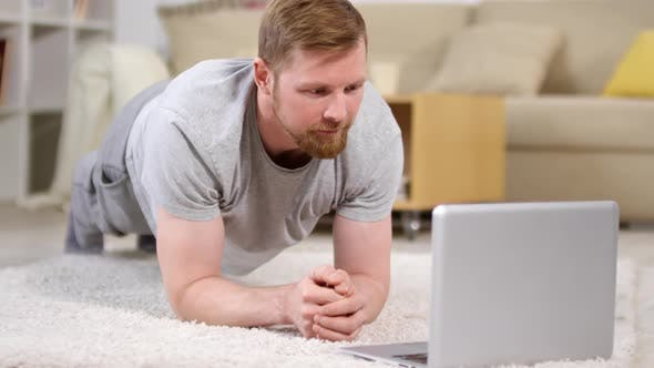 Thumbnail for Man Doing a Plank and Texting on Laptop