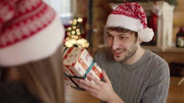 Thumbnail for Man shaking a Christmas hat