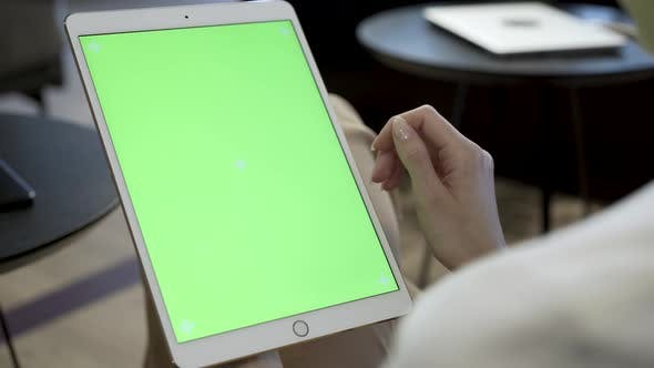 Thumbnail for Person Looking At Green Screen Of Tablet Device