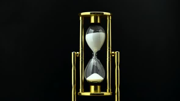 Thumbnail for Time Passing While Sand Falls Through Hourglass. Black Background