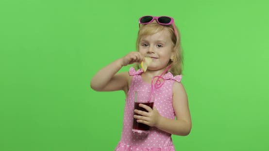 Cover Image for Child in Pink Swimsuit Drinks Juice Cocktail with Drinking Straw. Chroma Key