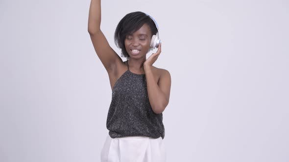 Thumbnail for Happy Young Beautiful African Woman Dancing and Listening To Music