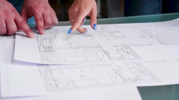 Cover Image for Close Up Hands of Architects Pointing on Blueprints