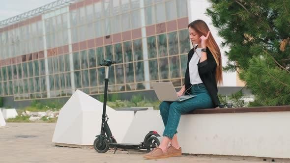 Woman Working Online In Park