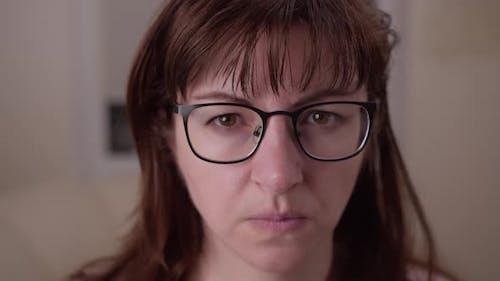Portrait Suspicious Woman Looking at the Camera Closeup
