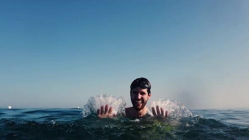 boy splash in the sea