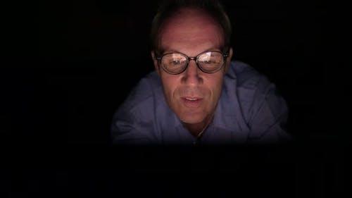 Mature Scandinavian Man Watching Adult Videos with Digital Tablet in Dark Room