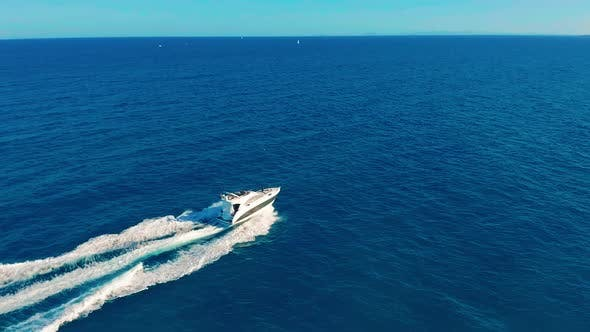 Thumbnail for Aerial View. Boat Moves on the Sea. One Boat in the Blue Sea. Concept Travel and Vacation.