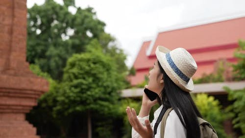 Woman talking on mobile phone and getting lost way