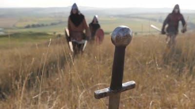 Warriors heading towards a sword