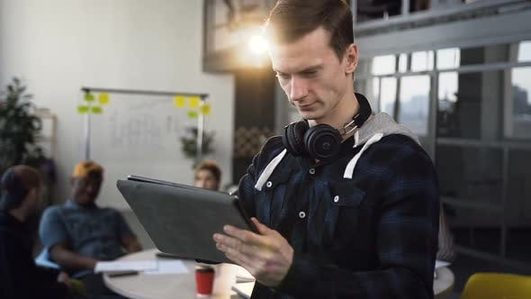 Cover Image for Focused Business Man Working on the Tablet