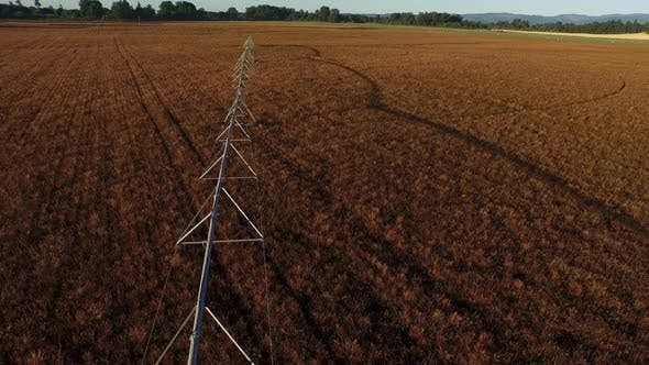 Thumbnail for Aerial shot of irrigation equipment in field at sunrise